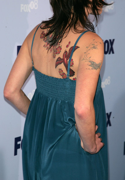Close Up Of Lena Headey's Bird and Flower Back Tattoos