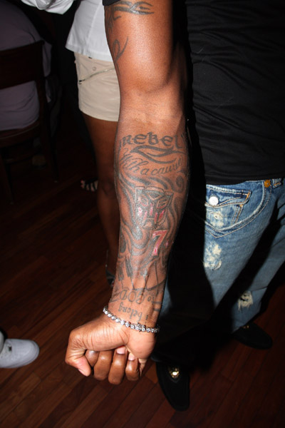 "In this pic Tyrese shows off his ""Rebel with a Cause"" arm tattoo."