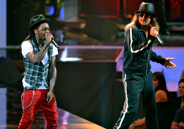 "Live performance photo of Lil Wayne and Kid Rock on stage at the 2008 MTV VMA at Paramount Pictures Studios in Los Angeles, California on September 7, 2008. ""Lil Wayne […]"