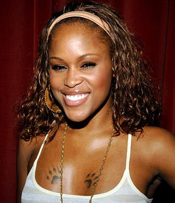 Celebrities Tattoos on Rapper Eve   S Chest Paw Tattoo Photo  Celebrity Tattoos   First Class