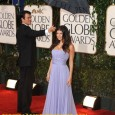 Fergie Poses on the Red Carpet of the 2010 Golden Globe Awards. Holding the umbrella, Husband Josh Duhamel protects Fergie from the rain. Fergie's red carpet hairstyle and dress at...