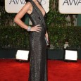 Olivia Wilde Poses on the Red Carpet of the 2010 Golden Globe Awards. Olivia Wilde's red carpet hairstyle and dress at the 67th Annual Golden Globe Awards held at The...