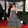 Tina Fey Poses on the Red Carpet of the 2010 Golden Globe Awards. Tina Fey's red carpet hairstyle and dress at the 67th Annual Golden Globe Awards held at The...
