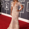 "Beyonce on the Red Carpet of the 2010 Grammy Awards. Beyonce's red carpet hairstyle and dress at the 52nd Annual ""Grammy Awards"" held at Staples Center in Los Angeles, California..."