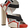 This Balenciaga criss-cross platform pump with an elastic band around the ankle is today's shoes crush. The red, grey and navy colors are perfectly balanced by the ivory. These Balenciagas...