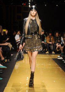 Model walks the runway at the Versace for H and M Fashion event